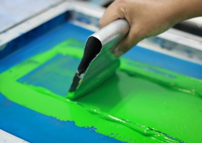 Hand pressing silk-screen printing, close up view.